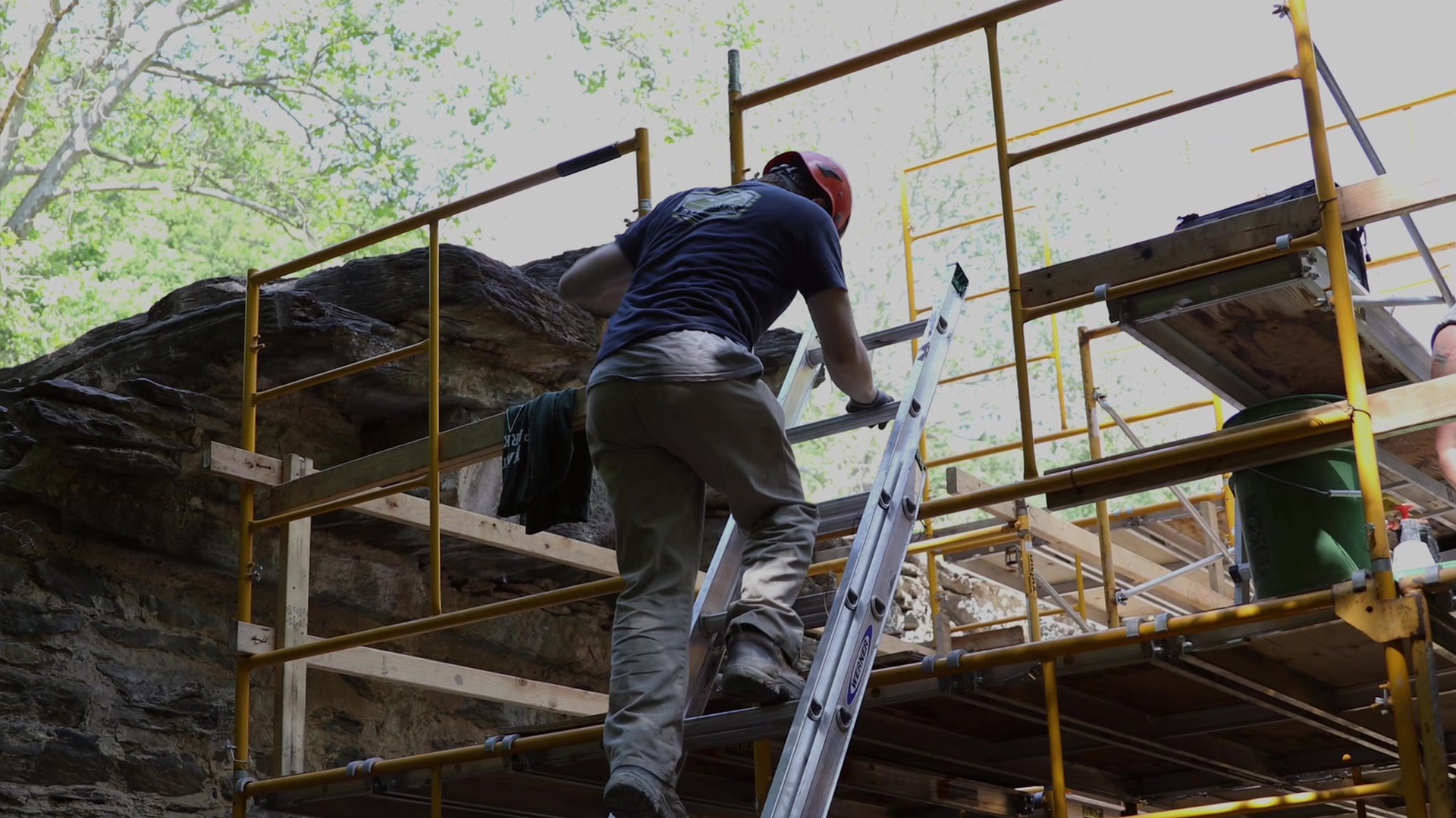 An NPS employee skilled in the traditional trades work at the Pulp Mill Ruins in Harpers Ferry, WV