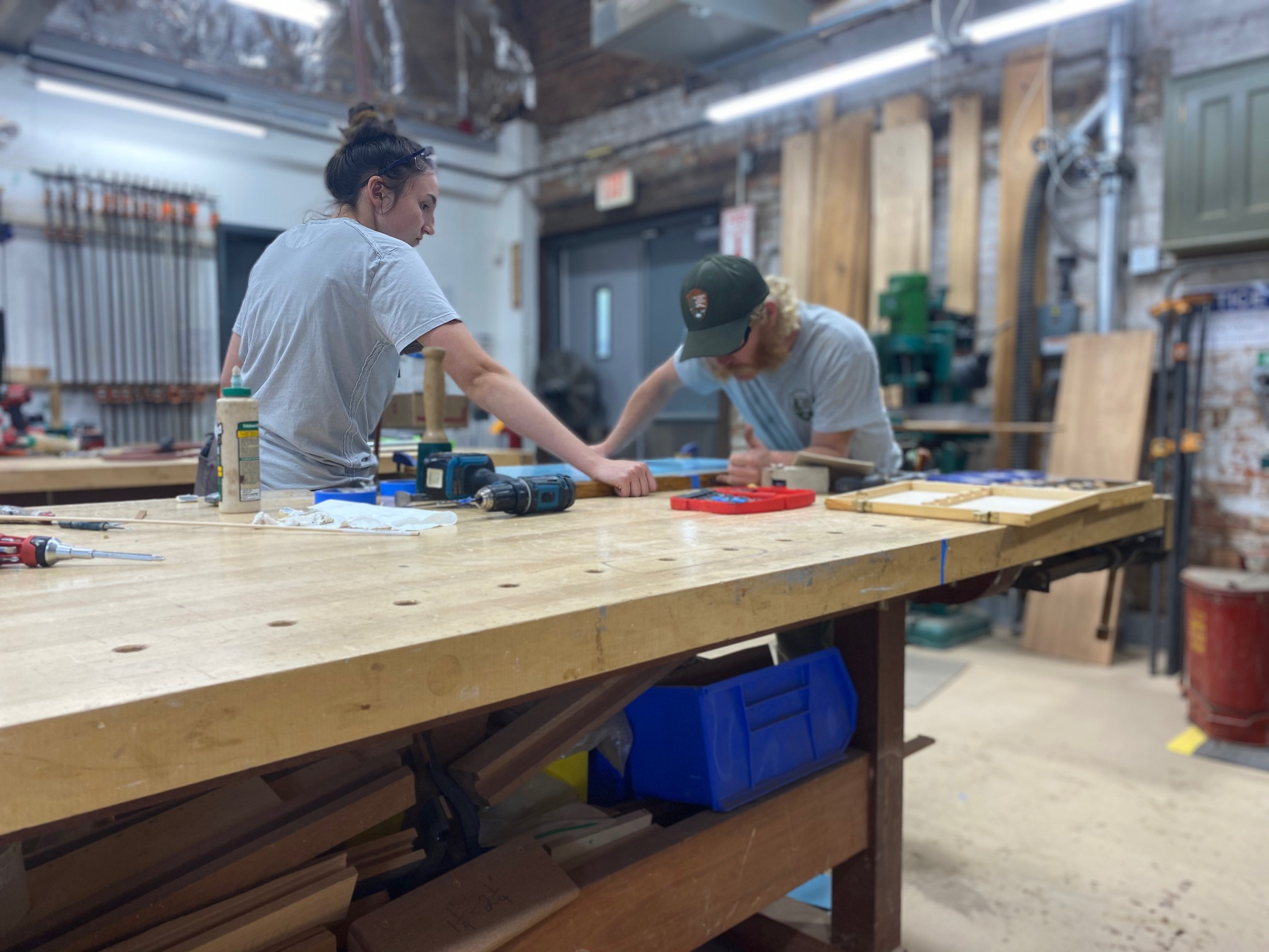 Trainees work on a historic window at the Historic Preservation Training Center in Frederick, Md.